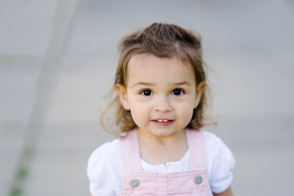 Toddler girl looking directly at camera, Chica