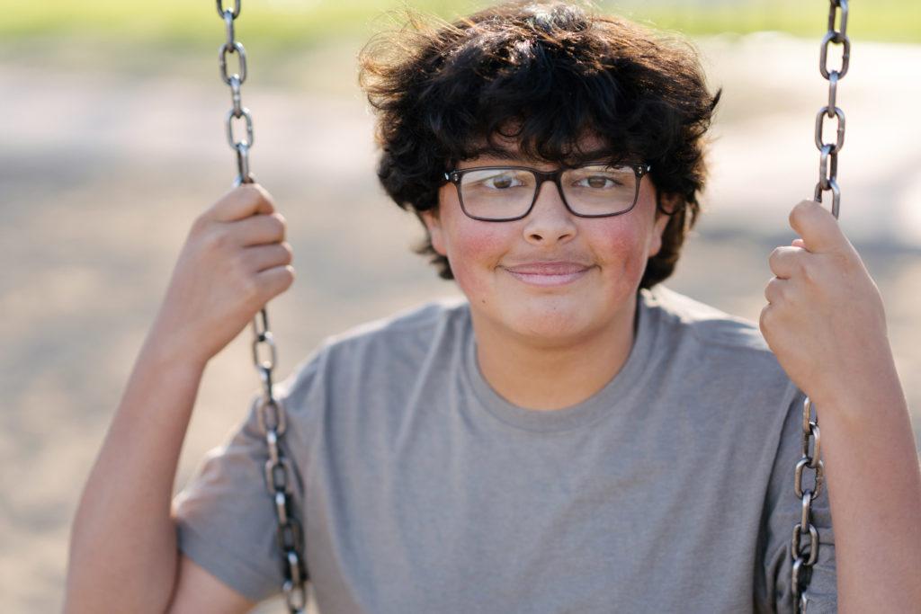 Teenage Latino boy on a swing
