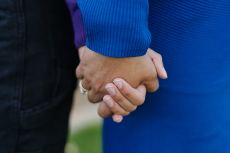 close up of mother holding teenage daughter's hand