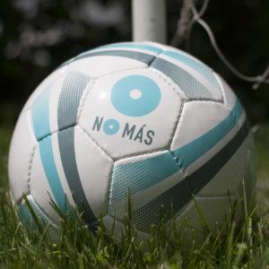 No Mas logo on soccer ball in grass